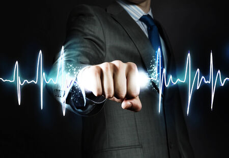 heart beat: Close up of businessman hand clenching graph in fist