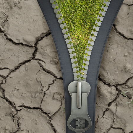 Conceptual image with opened zipper and green grass photo