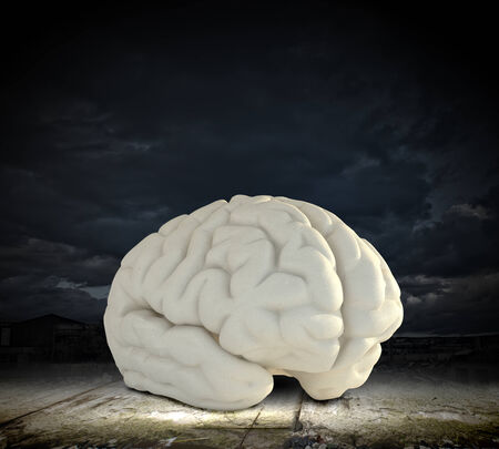 solver: Huge human brain against modern city background Stock Photo