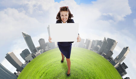 Top view of excited businesswoman holding white blank banner  Place for text photo