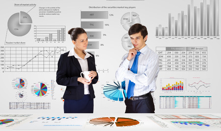 Businessman and businesswoman analyzing data information of market