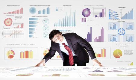 analyzing: Young businessman analyzing data information of market Stock Photo