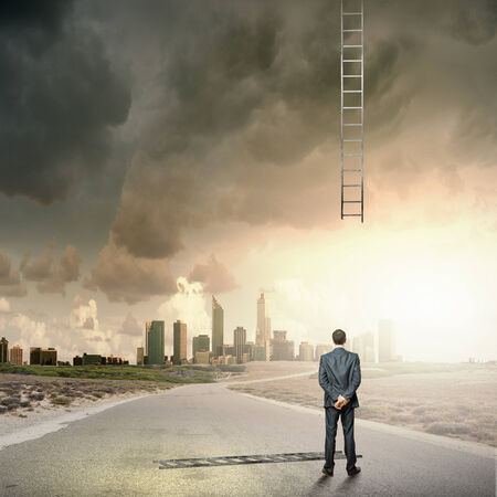 Rear view of businessman and broken ladder to sky Stock Photo