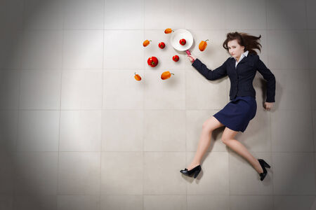 woman handle success: Funny woman in business suit with pan in hand Stock Photo