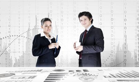 Businessman and businesswoman analyzing data information of market photo