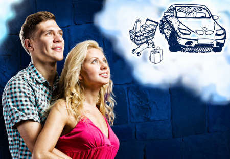 Young happy couple dreaming about buying car photo