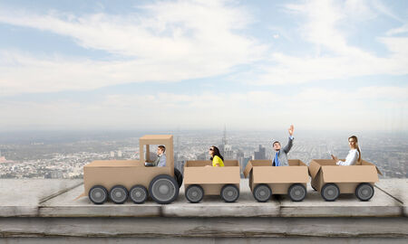 Business people riding carton train  Teamwork concept photo