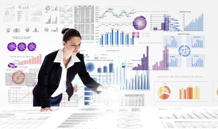 analyzing: Young businesswoman analyzing data information of market
