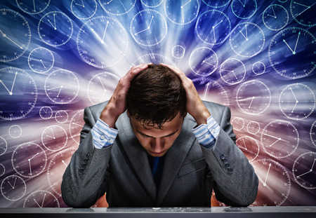 Troubled thoughtful businessman with hands on head photo