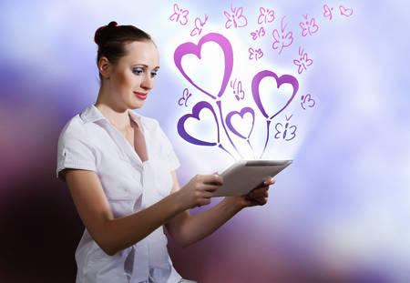 Young woman using holding tablet pc. Romance concept photo
