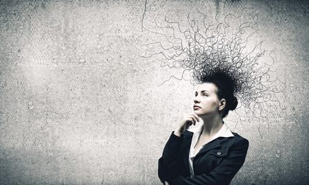 brooding: Young troubled businesswoman thinking over the ideas Stock Photo