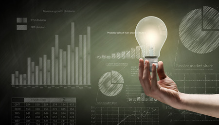 knowledge is power: Conceptual image with light bulb diagrams and graphs Stock Photo