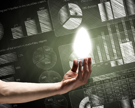 Conceptual image with light bulb diagrams and graphs photo