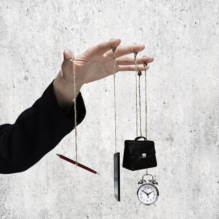 hand brake: Close up of business person hand holding office items on rope