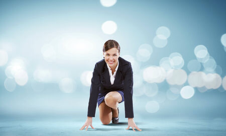 start position: Young attractive businesswoman standing in start position Stock Photo