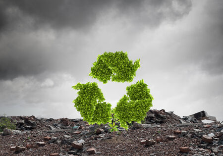 produce energy: Conceptual image with recycle green sign growing on ruins