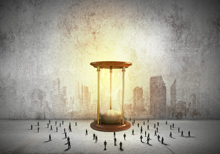 sandglass: Conceptual image with sandglass and silhouettes of business people around