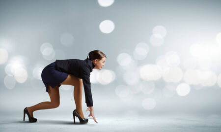 start position: Side view of businesswoman standing in start position