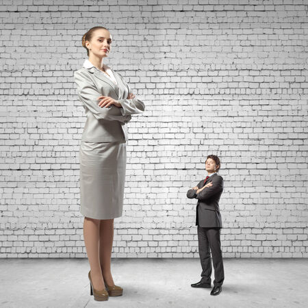 bossy: Miniature of young businessman and bossy businesswoman Stock Photo