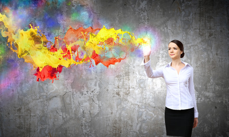 Young pretty woman in shirt and colorful splashes photo