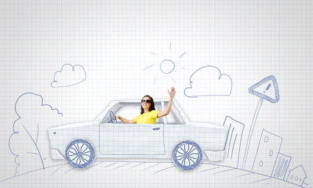 worldwide wish: Young woman riding car made of list of paper