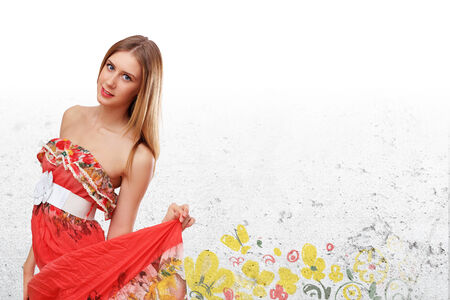 Beautiful young woman in red dress and flowers photo