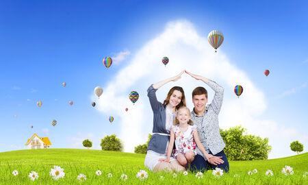 green: Happy family of three lying on green grass