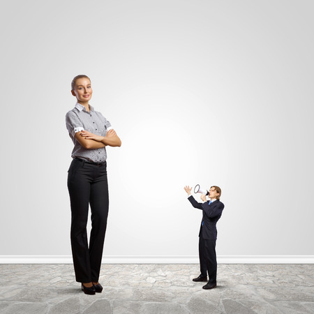 Businesspeople of various sizes. Business relations concept photo