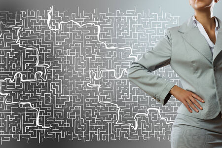cement solution: Close up of businesswoman with sketches at background Stock Photo