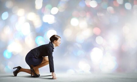 contender: Side view of businesswoman standing in start position