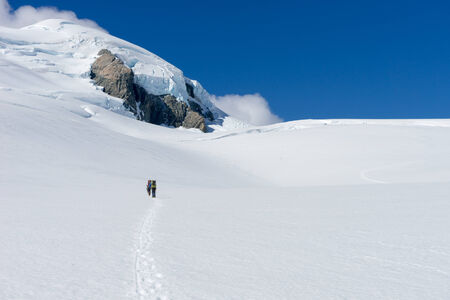 snows: People walking among snows of New Zealand mountains