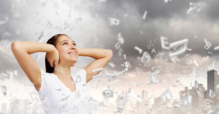 dissatisfaction: Young woman closing her ears with palms and enjoying the silence Stock Photo