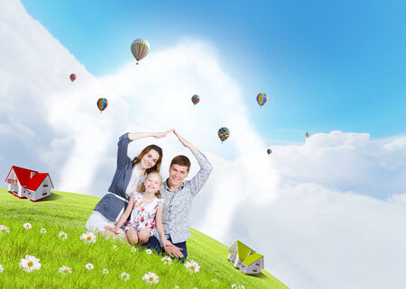 house clean: Happy family of three lying on green grass