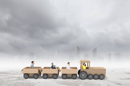 real leader: Business people riding carton train. Teamwork concept