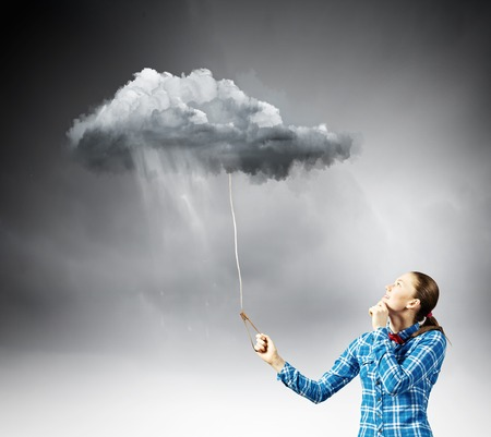 Young woman in casual holding cloud on lead photo