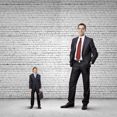 little business man: Two businessman of different size. Leadership concept