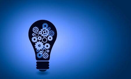 business teamwork: Conceptual image of light bulb with cogwheels inside
