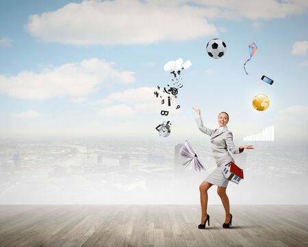 virtuoso: Young pretty businesswoman juggling with white balls