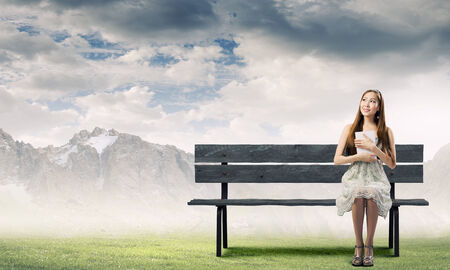 Asian pretty woman sitting on bench and reading book photo