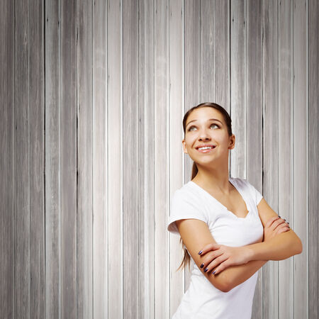 Young smiling woman with colorful thoughts above head photo
