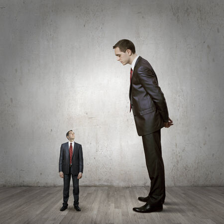 Two businessman of different size. Leadership concept photo