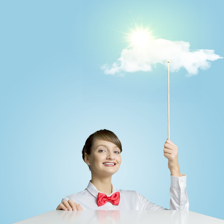 Young woman holding balloon with sun shining above photo