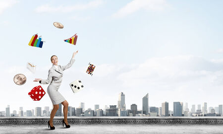 multitask: Young pretty businesswoman juggling with white balls