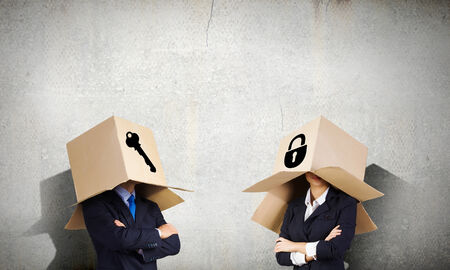 cowardice: Unrecognizable business people with carton boxes on head