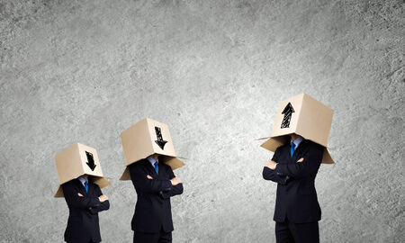 unrecognizable: Unrecognizable business people with carton boxes on head