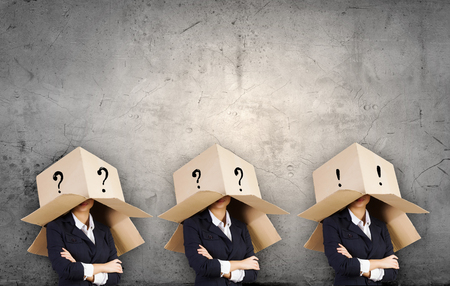 Business people with carton boxes on head photo