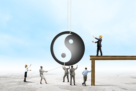 Group of businesspeople and yin yang sign photo