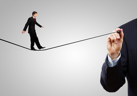 Businessman walking on drawn line. Risk concept photo