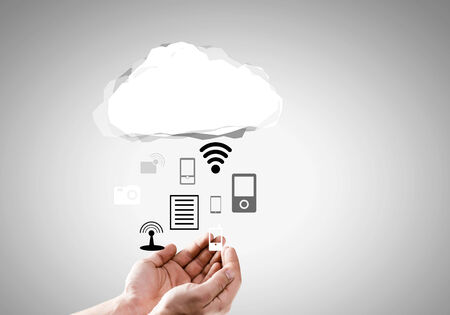 Close up of businessman hand holding cloud with media icons photo