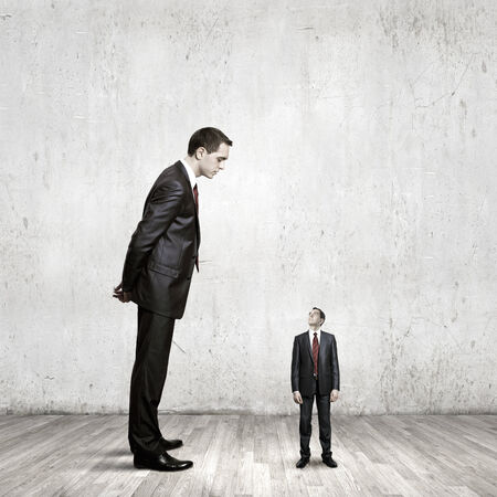 big and small: Two businessman of different size. Leadership concept